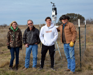 HSU environmental science students Karissa Olson, Michael Flud, Isaiah Longoria with professor emeritus Dr. George Newman and a weather station at Newman Ranch. (Photo by Marla Potess)
